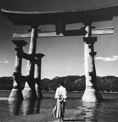 Inspiration: A Shinto priest at the torii (gate) of Itsukushima Shrine at low tide on Itsukushima Island, Japan, circa (Photo by Three Lions/Hulton Archive/Getty Images) Hiroshima, Vintage Photographs, Vintage Photos, Black White Photos, Black And White, Torii Gate, Miyajima, World Religions, Japan Photo