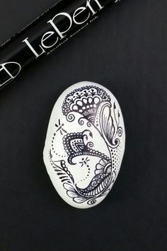 ••• Alaska Art Stones ••• Finished this rock yesterday, black LePen Permanent art pen on painted rock. Tried something new, a new style of flower. I like it! Might try little bumble bees next :-) North Pole, Alaska