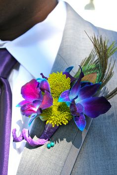 Corsage idea for a groom...for a teal, purple, green amd hot pink wedding