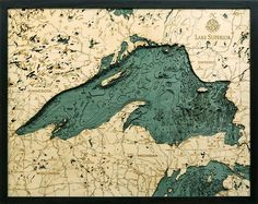 "Bathymetric Map of Lake Superior. Extremely accurate bathymetric map of Lake Superior and surrounding area. This three dimensional map is carved from Baltic birch wood, framed and has a acrylic covering to protect the wood. Dimensions: 24.5""W x 31""H Price: $358.00 -- on ScrimshawGallery.com #map #bathymetric"