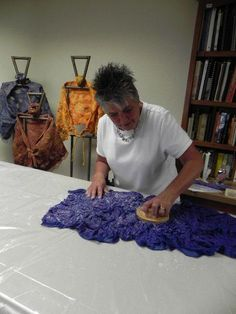 This picture is from one of Deb Tewell nuno wet felting classes. Just look at those lovely shawls! Also a great picture of the HeartFelt Silks' Palm Washboard being used! Thank you Deb and Linda!