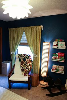 Alayna's Nursery Tour - Deep colors, bright patterns and vintage travel theme.  IKEA Poang with vintage blanket.