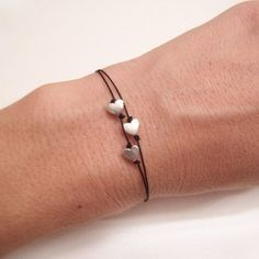 Three tiny sterling silver heart bracelet for Valentine's Day.