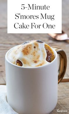 """Craving something sweet right this second? Grab a mug and start """"baking"""" this S'mores Mug Cake recipe for toasty, gooey results in five minutes. No campfire required."""