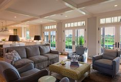 Nantucket Home with New Coastal Interiors. Living Room with garden views and a clean color palette using gray and mustard. Nantucket Home, Basement Remodeling, Basement Storage, Basement Plans, Living Room Remodel, Luxury Interior Design, Living Room Furniture, Living Rooms, Basement Furniture