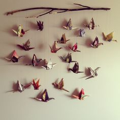 My version of the paper crane mobile. Spray painted branch and beautiful cranes #papercrane #mobile #origami
