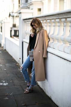 Emma Hill wears camel coat, black sweater, ripped jeans with raw hem, miu miu mis matched ribbon ballet flats, Gucci dionysus bag, chic winter outfit