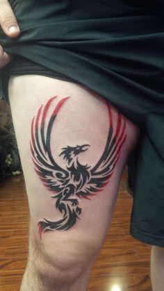 tribal phoenix tattoo man thigh black and red