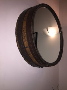 Hand made from the top of a reclaimed oak whisky barrel and with a mirror inserted on to the barrel top, this unique mirror looks fantastic on any wall and is a unique centre point #reclaimed #whiskybarrel #mirror #reclaimedtimber #whisky #handcrafted #handmade #madeinscotland