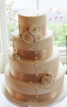 cream rose & pearl wedding cake by Jill The Cakemaker, via Flickr