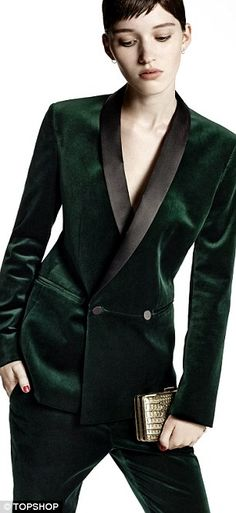 Topshop's green velvet suit. This is a suit style similar to the double breasted post world war two style seen in men's wear in the 1950s. The fabric choices and color choices are more modern, also the lapel width is slimmer, and there is only one set of buttons, all of these choices make this a more modern and trendy look. Also, re-appropriating the traditionally men's jacket onto a women gives the style a new life. 2/22 Addy Forte