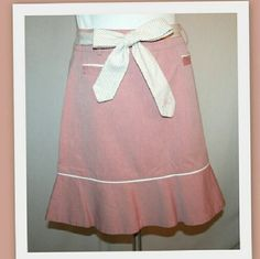 "Marc Jacobs pink cotton skirt This girly skirt has an A-line cut, white ruffled hem with white piping. The skirt appears pink from afar, but up close the fabric is actually red and white threads that created blush pink cast. Horizontal front pockets. Tan and white striped skinny tie belt is monogrammed with 'MJ' in pink.   100% cotton   Waist 30""  hips 40"" length 19"" Marc Jacobs Skirts A-Line or Full"