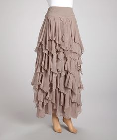 LOVE! LOVE! LOVE! LOVE! LOVE! LOVE!  Sweet, chic and enchantingly ethereal, this stunning skirt exudes effortless allure. Boasting fluttery ruffled tiers of fabric and a feminine, flattering silhouette, this pretty piece is destined to become a front-of-the-closet favorite.