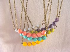 Colorful necklaces with czech beads, from Faunayflorashop on Etsy...these are sweet!