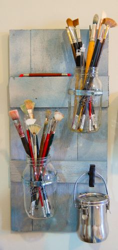Mason Jars can make fantastic organizers!  Here is a tutorial on how to make Mason Jar Wall Holders by Grinninglikeanidiot.com
