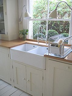 I love the way the sink has been intergrated into the units - the spotlights are a nice touch