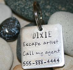 :-) this is just what me dog needs---Hand stamped dog tag  Escape artist aluminum dog by iiwiiemporium, $10.00