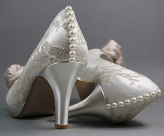 I like the color and buttons on the back... I do not like the bow. peep toe is ok  SAMPLE SALE Custom Wedding Shoes  Dark Ivory by DesignYourPedestal, $165.00