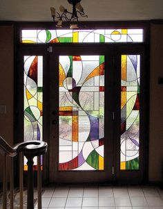 Entry doors are flanked by colorful stained glass