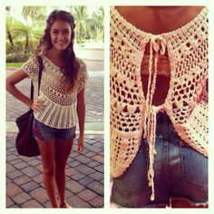 I am loving this crochet shirt from Urban Outfitters. The open back is my favorite!