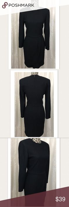True Vintage Joan Leslie Studio Little Black Dress Black long sleeve with faux wrap skirt. Rear zipper slight padding at the shoulder that accents the pin tucked waist. Size 4. True to size. Please note the last photo there is a small home back of right arm area. Difficult to see Vintage Joan Leslie Dresses Midi