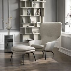 The new Dublin armchair by Henrik Pedersen is generous in scale and big on comfort- using moulded foam to give it a more uniform look. Elevate its grand character with a matching footstool for additional support and comfort. Choose from 100+ premium fabric and leathers.
