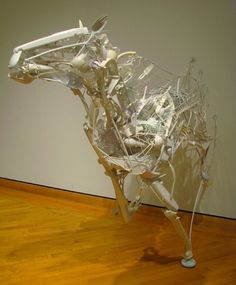 """Sayaka Ganz's fascination with animals in movement permeates this collection. """"When you look at the piece from the distance you see the form of the horse galloping, but when you get up close you start to see that individual objects were used"""", she writes."""