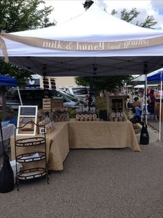 Milk honey (and grains) farmers market stand. Burlap, weathered wood apple crates, and chalkboards used to display our healthy baked goods--granola and cookies. Market Stall Display, Farmers Market Display, Market Table, Market Displays, Soap Display, Farmers Market Stands, Farmers Market Signage, Produce Displays, Cookie Display