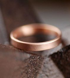 This brushed rose gold wedding band is made from recycled materials. (Oh, and it's available in reg'lar gold too.)