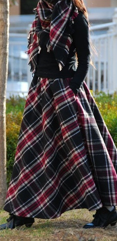 I would wear this long plaid skirt and matching scarf with black boots.