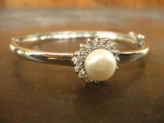 Rare 10k Victorian white gold large pearl and white stone bracelet bangle $1,500 on Etsy from HouseOfRene with FREE SHIPPING WORLDWIDE    https://www.etsy.com/shop/HouseOfRene