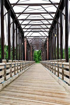 Chippewa River walking bridge - Eau Claire At the end of the bridge graduates would tie their shoes together and toss them up. This bridge is walked on, biked on, run on, sat on, and pondered on :)