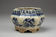 Incense burner: Possibly made in Henan, China. 1933 (dated). Stoneware, decorated in underglaze cobalt blue. Decoration: Floral designs (sketchily executed) and inscription 'Made in a winter month of the 22nd year of the Chinese Republic, the mountains are clear and the waters are lovely, the mountains are colourful and the water bright'. 'Minguo Sun ji' (Sun and company. Republic) in square raised seal on base. (V) -  'Minguo Sun ji' (Sun and company. Republic) in square raised seal on base