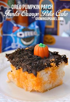 """Turn an orange poke cake in to a fun pumpkin patch this Halloween! Use chocolate frosting and crushed cookies for """"dirt"""" and then add some candy pumpkins. Don't forget some gummy worms, too!"""