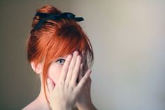 Red hair with navy blue bow.
