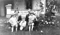 Floyd Gipson Brassfield and his family moved to Lake City, Iowa around 1926.  It is Irene, Thelma, Elvis, Floyd and Betty Brassfield in front of Middleton house on South street in Lake City.  the for sale sign just behind them appears in several photos even a year later. Behind them are some plants that are trying to climb some strings similar to the ones in the Cherokee, Iowa photo.Also notice the truck at the right. Floyd operated a trucking company after moving to Lake City