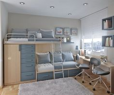 Great design for a shared boys room with two beds and two studying desks.