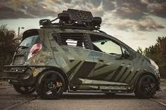 Chevrolet Spark would look great as an army warfare vehicle. C,early this is something that they should try :p Chevrolet Spark, Chevrolet Trax, Spark Tuning, Spark Gt, Honda Fit, Army Vehicles, City Car, Smart Car, Car Wrap