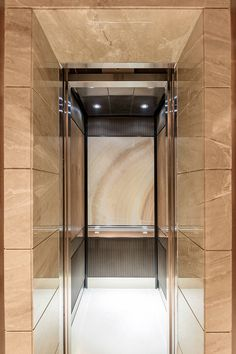 LEVELe 106 Elevator Interior With Customized Panel Layout; Capture Panels  In ViviStone Cream Onyx