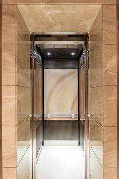 LEVELe-106 Elevator Interior with customized panel layout; Capture panels in ViviStone Cream Onyx glass with Standard finish, Bonded…