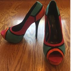 Stunning Multi Colored Platform Heel Beautiful combination of blue, orange, pink, and black make up this adorable heel. Worn once. Well loved and cared for with price accounting wear (fabric slightly lifting on bottom of heel as shown in pic). 15% off all bundles! Thanks for looking! Shoes Heels