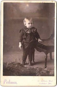 Old Photo - Odd Little Boy with Bow - The Graphics Fairy