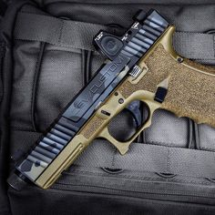 Zev coated in MADland Camo with a hint of FDE. #cerakotemadness #madcustomcoating #glock