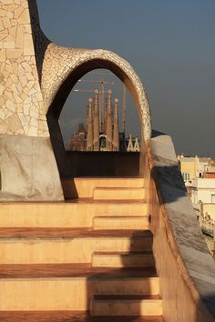 La Sagrada Familia dominates the skyline of Barcelona from pretty much everywhere you look. This photo was taken from the roof of La Pedrera, where it was framed by one of Gaudi's arches.