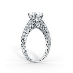 Award winning design. This timeless classic is a tapered engagement ring from the Stella and most prized creations collection. It features 1/6 ctw of diamonds. The signature handcrafted details include wheat hand engravings, signature filigree, peek-a-boo diamonds and milgrain edging. The center 1 carat princess stone (shown) is a customized option.