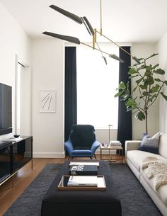 """While most of the original layout of the apartment stayed the same, Gachot did open up the main living space to create a media room. As in the other spaces, black has a strong presence in the palette here. """"Black is so grounding and elegant,"""" Gachot explains 