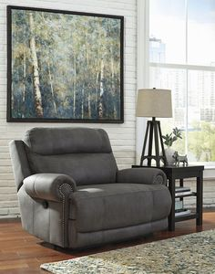 The Austere collection is perfect for reclining without the bulky look.  Available through Trends Furniture