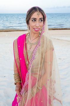 Bride in Pink and Gold Lehenga | Indian Fusion Wedding | Bridal Lehenga: @Poshaac | Adrienne Fletcher Photography @adrinfletcher | Venue: Moon Palace Golf & Spa Resort in Cancun, Mexico @prweddings