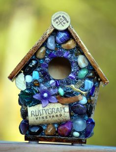 Whimsical garden birdhouse with purple flower and wine corks. $45.00, via Etsy.