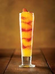 Johnny Carino's Bellini  peach nectar, white wine, champagne and rum, swirled with Italian Sangria